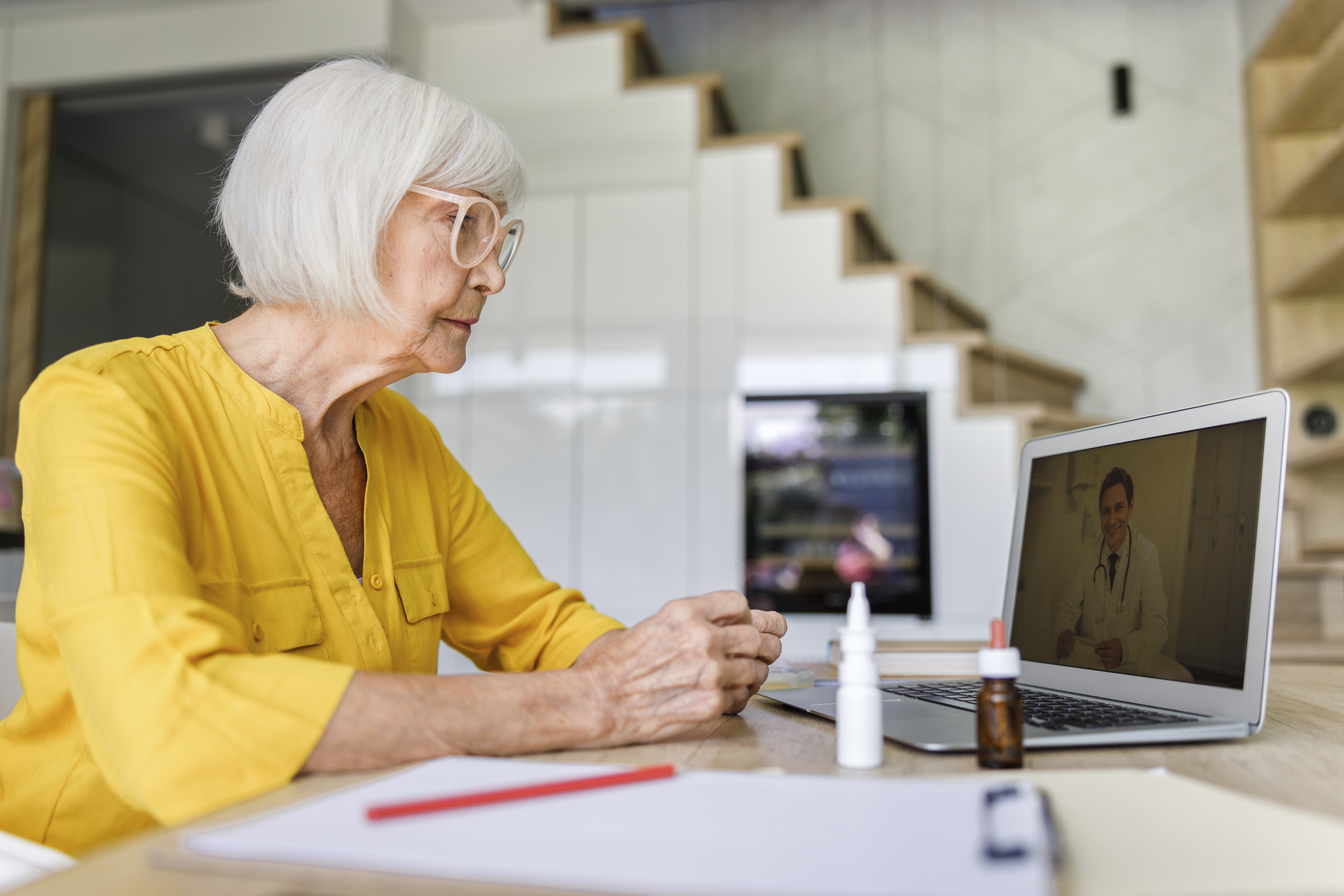 Woman on telehealth meeting with doctor